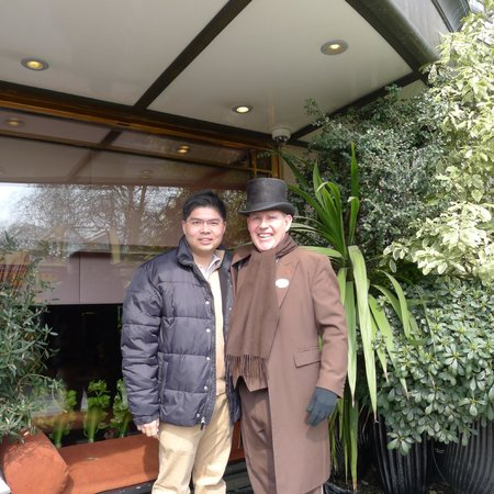 The Athenaeum Hotel & Residences: Picture with the doormen