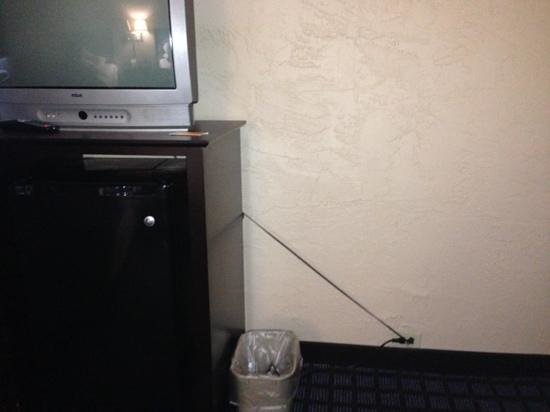 Rodeway Inn: TV plug stretched to the limit... safety hazard.