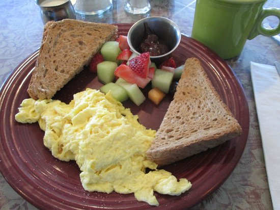 The Breakfast Table: Scrambled eggs, toast and fresh fruit