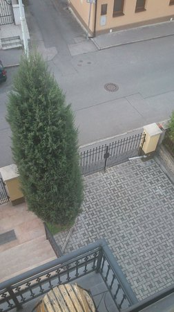 Pension Paldus: View on parking place from balcony (Room No. 5)