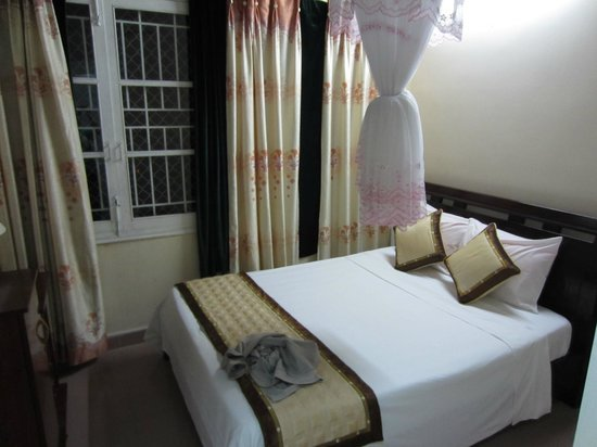 Nature Homestay: The bed which comes with mosquito net