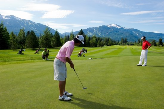 Whistler, Canada: Golfers at Nicklaus North Golf Course. Mike Crane