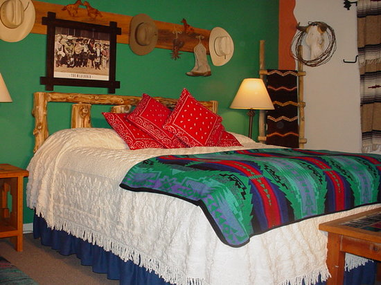 Inn on the Rio: Buck-a-roo room with hand carved King bed