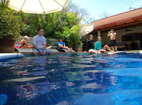 Surf Simply: Hanging around the pool while instructor Jessie gives some efficient paddling tips.