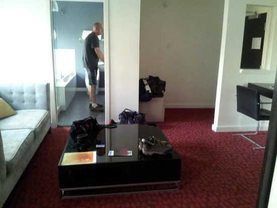 Moda Hotel: View from bedroom into living area and bathroom (he's washing his hands it ok)