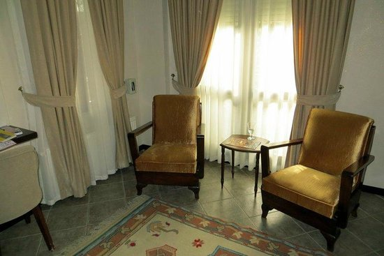 Ephesus Suites Hotel: Sitting area in the living room.  There was also a couch, TV, AC
