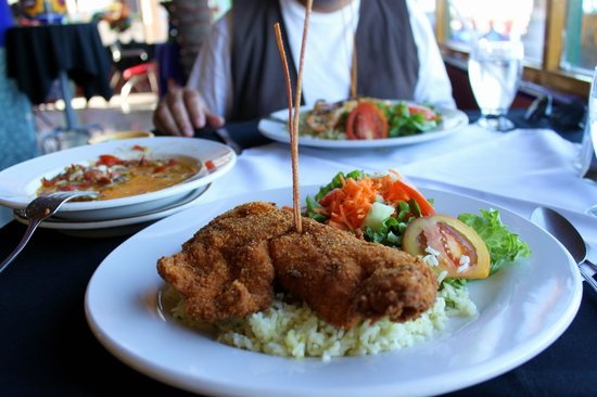 Loreto Islas: Breaded fish dish accompanied with rice and salad.  Fish is soft inside and crunchy on the outsi