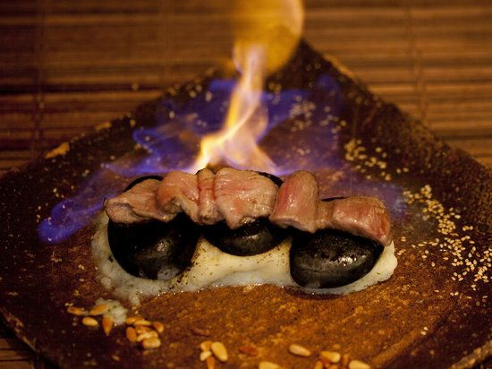 Kyoto Joe: Slices of beef loin flambed in rum, served with garlic teriyaki sauce
