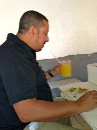 My husband enjoying his lunch in El Rey del Taco