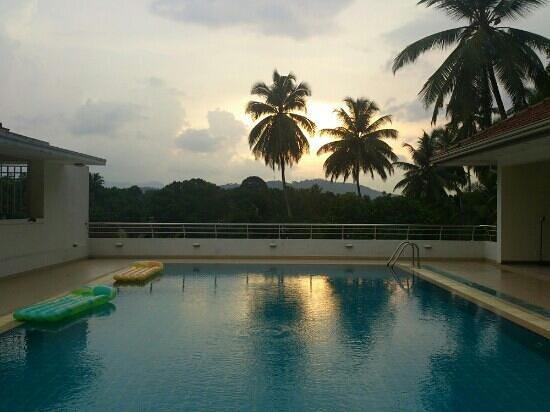 Serene Villa Ratnapura: sunset by the pool
