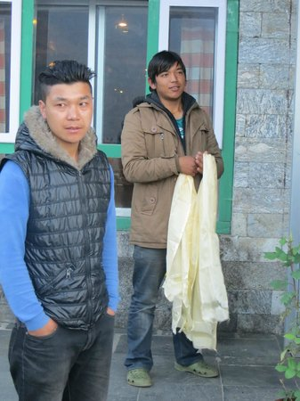 Yeti Mountain Home Lukla : Being presented with a scarf by management