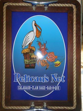 Pelican's Net Coastal Grille & Draught House: Sign outside the restuarant