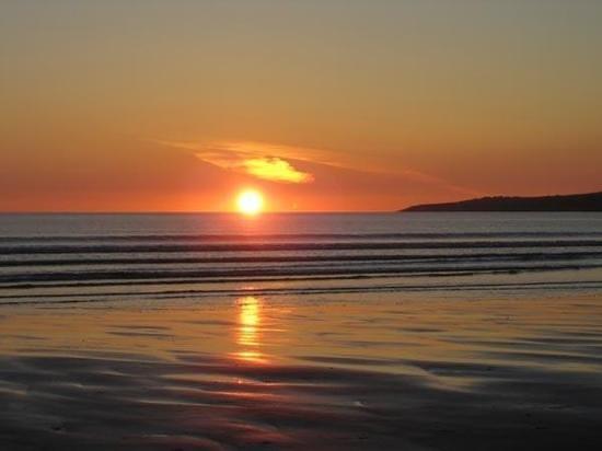 sun setting over Ballyheigue Strand
