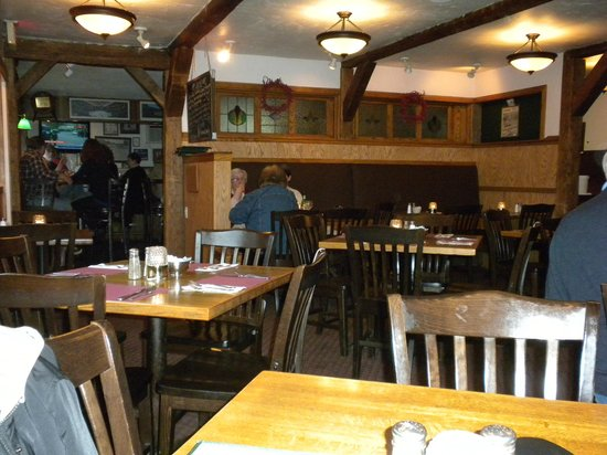 Hooligans Food & Drink : The dining room - bar in the background
