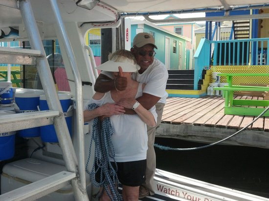 Grand Lucayan, Bahamas: Captain PK (Phillip Kemp) hugging me bye-he was so nice