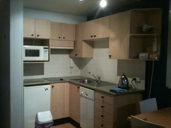 Manly National Apartments: tiny kitchen functional but scarce utensils- no whizz etc