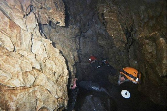 The Legendary Black Water Rafting Co.: Climbing out toward the cave entrance