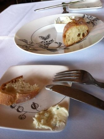 Lilac: bread and butter on random mismatched dishes