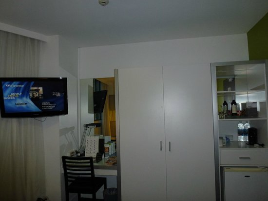 Vibe Hotel Sydney: View from bed:  TV, desk, closet, coffee pot