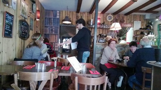 La Cidrerie du Marais: Interior of the cosy cafe, with our very friendly and helpful server in the dark shirt.