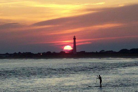 Sunset Beach: Gorgeous with sun framed by the lighthouse