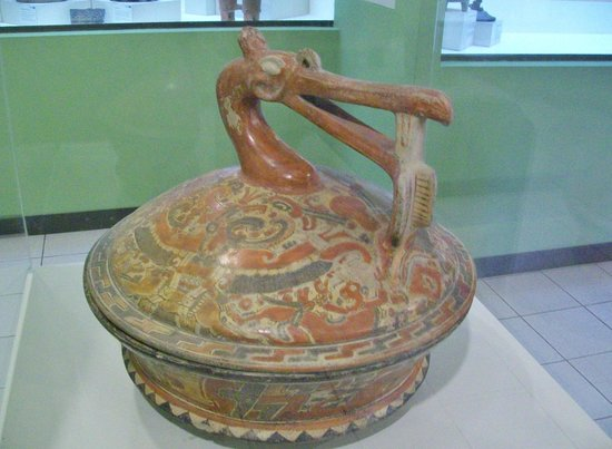 Museo Popol Vuh : Mayan god eating a fish on this finely crafted pot and lid