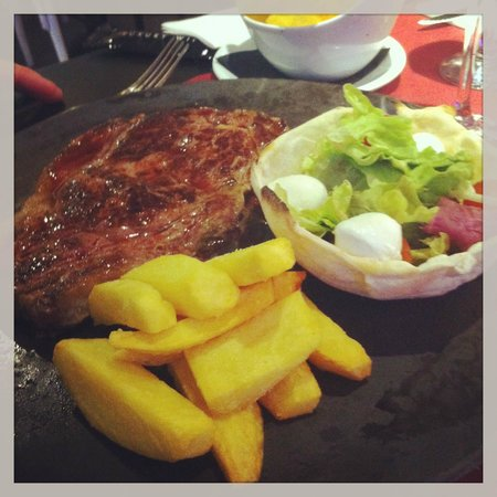 Portofino : Nice juicy steak cooked to perfection home made chips and edible salad bowl