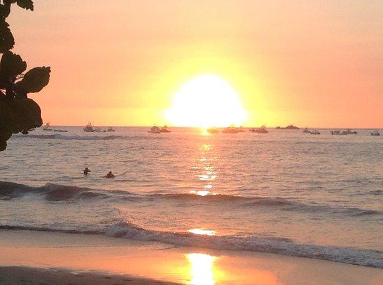 Sun sinking into the horizon at Tamarindo Beach