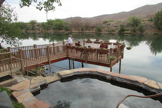 Riverbend Hot Springs : One of the pools and deck overlooking the river