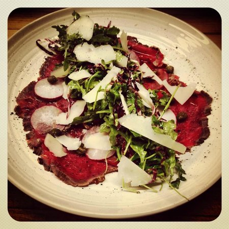the Sovereign Room: Lunch Example. Beef carpaccio, radish, capers, radicchio and arugula salad