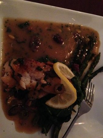 Basilico: Seared wild cod with pine nuts and olives over spinach