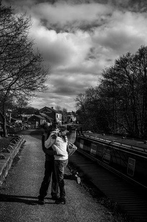 Couple on canal near Cafe Cargo