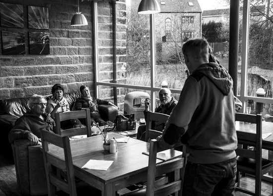 Local man speaks to a group of visiting Australians, Cafe Cargo.