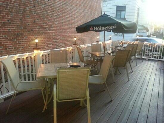 Signatures Restaurant: The patio complete with music and overlooking a fountain