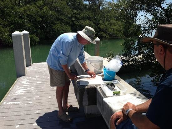 Lucky Dawg Fishing Charters: Jack cleaning our fish