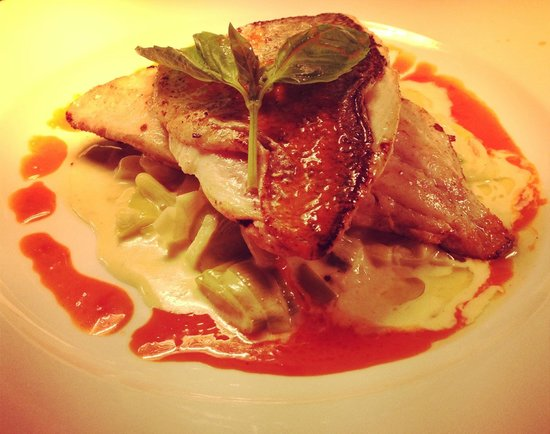 Manbo's: pan fried sea bream, on a bed of creamed leeks, served with a red pepper sauce.