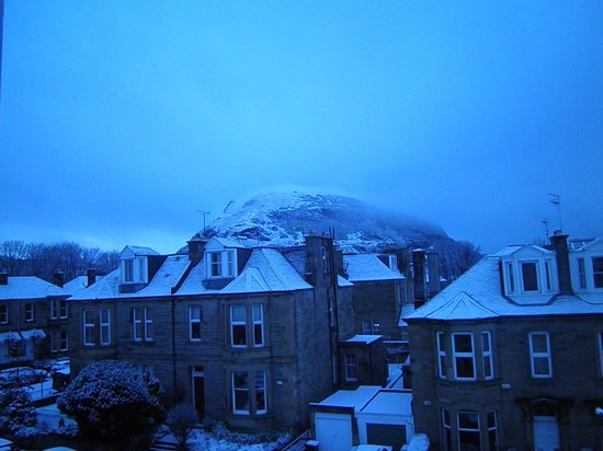 Hotel Ceilidh-Donia: The view from our room of Arthur's Seat.  It snowed overnight!