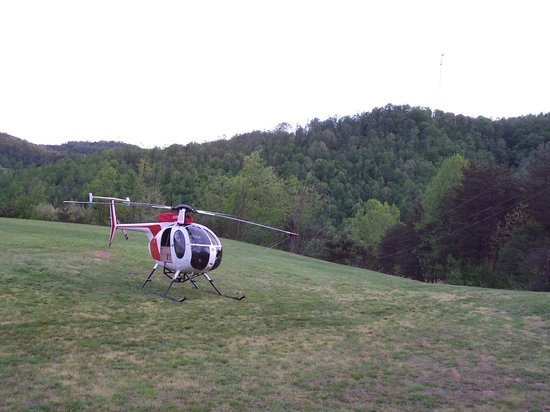 Microtel Inn & Suites by Wyndham Gassaway/Sutton: Helicopter Beside Parking Area