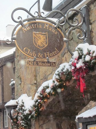 Austria Haus Hotel: Austria Haus sign on a snowy day during our visit