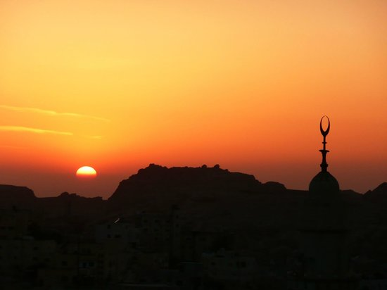 Amra Palace Hotel: Sunset view from our room