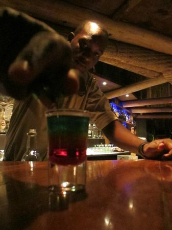 """Baoase Luxury Resort: juan carlos at the bar, about to set a """"bob marley"""" on fire"""