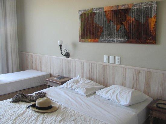 Hotel Don Quijote: Cama de solteiro e cama de casal da suíte luxo