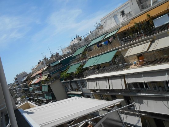 Acropolis Select Hotel: the view of the bustling city from out great patio