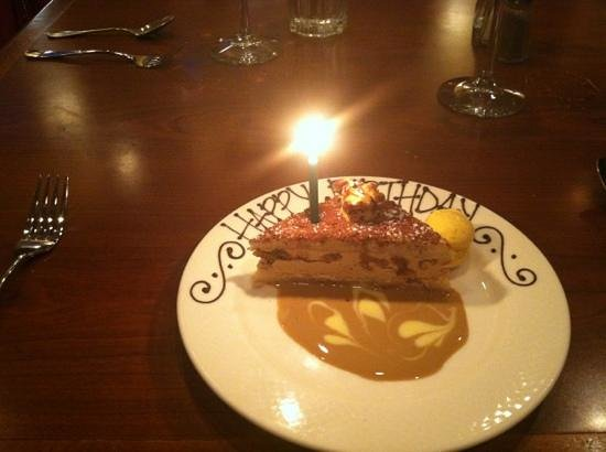 Praline Bakery & Bistro: Walnut daquoise for birthday ( not free)