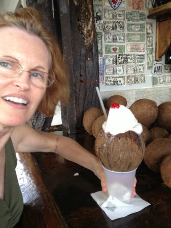 Rum Runners : Her favorite drink here...frozen pina colada in a fresh coconut!