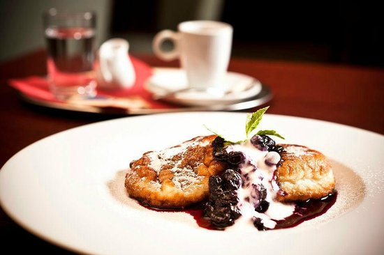 Homemade pancakes with blueberry sauce and sour cream
