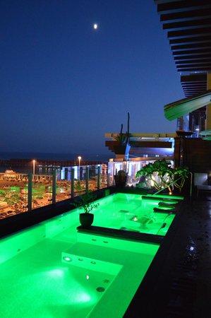 Romeo Hotel: rooftop swimming pool lights at night