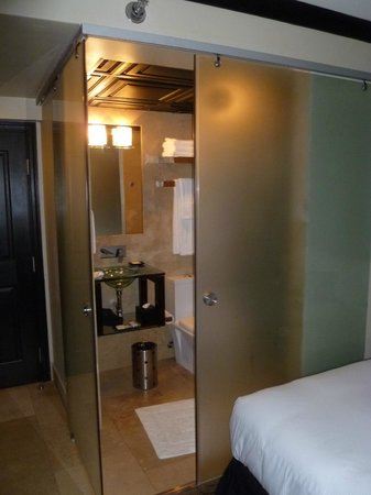 Hotel Duval, Autograph Collection: Bathroom sliding door slightly open