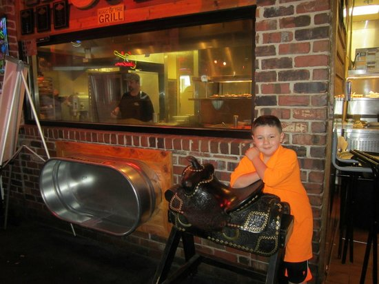 Texas Roadhouse: Reese loved all of the props and he was able to watch them cook our steaks.