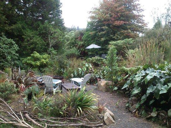 Wairua Lodge - Rainforest River Retreat: Pond, brazier and seating.